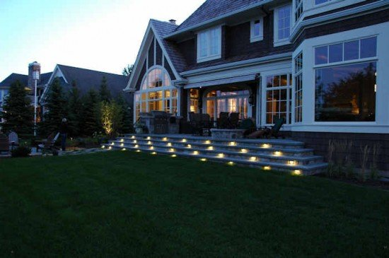 High end landscape lighting touchstone accent lights wide steps topped by a gorgeous patio is a great place to entertain aloadofball Images